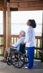 female caregiver with male senior client